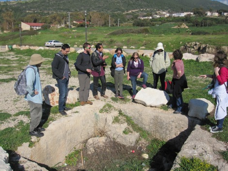 Discussing the merits of an ancient wine press just a few meters from the seashore!