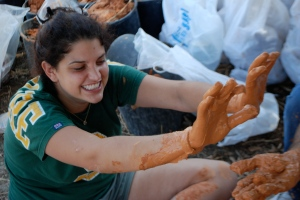 Gail, getting her hands dirty exploring the construction of mudbricks and earthen plasters.