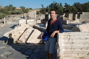 Yonatan leaning against a fallen column in the historic Roman city of Beit She'an.