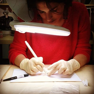 Saving the Stones 7 intern Laurine Bahloul, working on a lead bullet in the metals lab of the Israel Antiquities Authority. The bullet was found in our home in Akko!