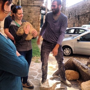 Collecting sandstone blocks in preparation for masonry exercises with master stone mason, Yotam Carmel.