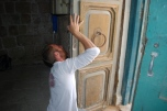 Removing the Ottoman period door for treatment.