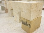 Setting up raw stone blocks to be carved.