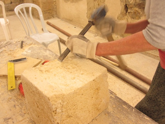 Shaping a stone.