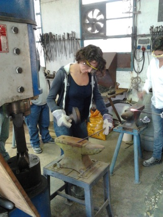 Learning traditional blacksmithing.
