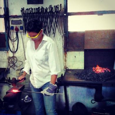 Learning traditional blacksmithing.